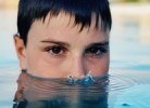Close-Up Portrait Of Man Emerging From Water In Swimming Pool
